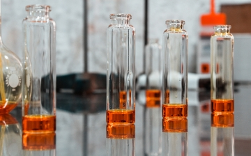Image of glass vials containing samples of essences and oils in a Fragrances and Essential Oils comp